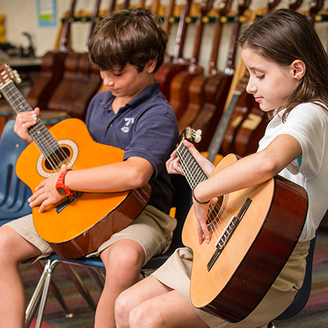 Woodward students playing guitar